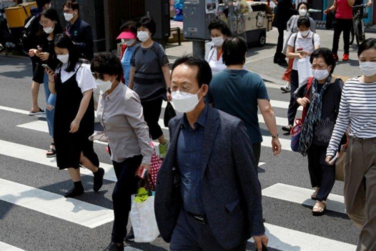 Güney Kore'de aşı olanlar temmuzdan itibaren maske takmak zorunda kalmayacak