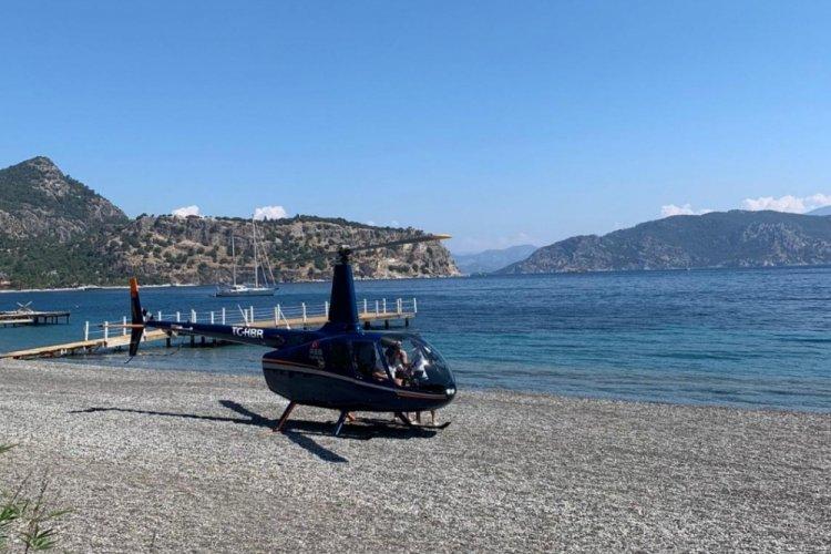 Helikopter plaja indi, güneşlenenler şaşkınlık yaşadı