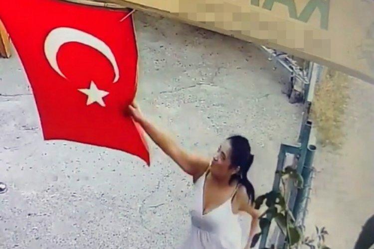 Türk bayrağını koparan kadın, çöpe attı!
