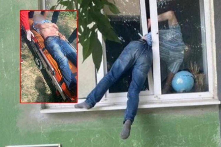 Herson'da sarhoş adam camdan eve girmeye çalıştı