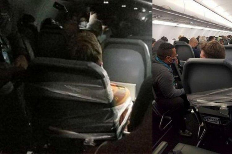 Uçuş görevlilerine saldıran yolcuyu koltuğa bantladılar