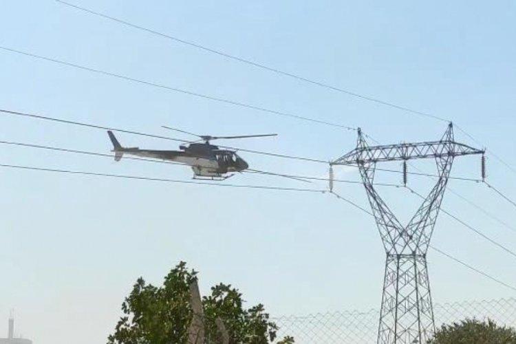 Yüksek gerilim hattı helikopterle temizlendi