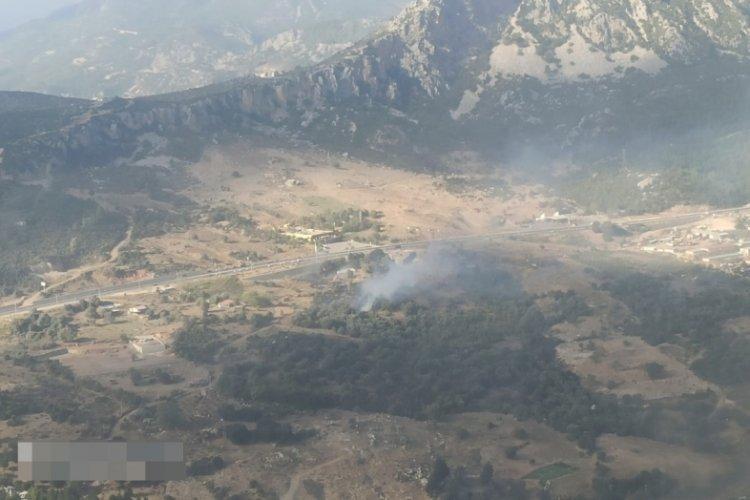 Antalya'da makilik alanda çıkan yangın sonucunda 10 dönüm alan zarar gördü