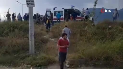Bursa'da kamyonun sıkıştırdığı taksi şarampole sürüklenerek takla attı! 2 yaralı var